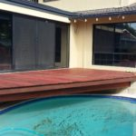 Jarrah deck to over hang a pool with hardwood steps. Perth outdoor carpentry