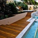 Photo Decking around a pool with header tiles.