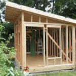 Timber frame. Backyard building.