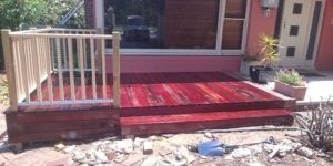 Photo of 140x22mm oiled jarrah decking with step and balustrade. Perth outdoor carpentry